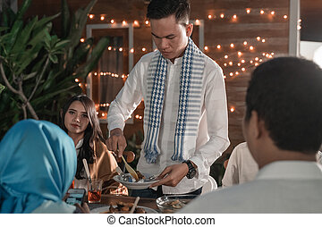 Happiness of frienship when enjoy eating iftar together -...