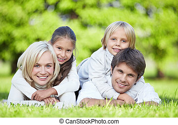 Happiness - A happy family with children outdoors