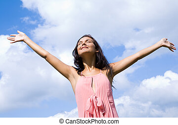 Happiness - Portrait of happy girl praising God with her...