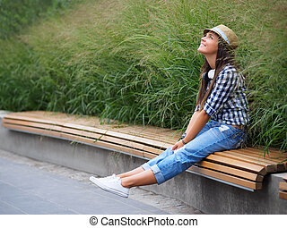Happiness - Smiling attractive girl on the bench