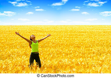 Happiness - Happy young woman in the field