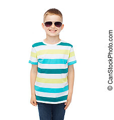 smiling cute little boy in sunglasses