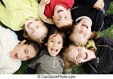 Happiness without limit, happy group of children in circle,...