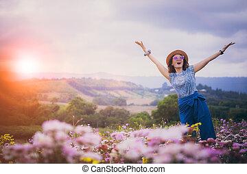 happiness woman in beautiful flower garden