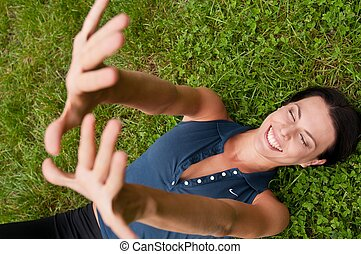 Happiness - woman lying in grass