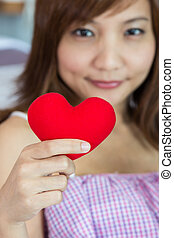 Happiness women show with heart shape in hands