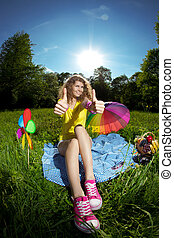 Happiness young beauty woman at a picnic in the par thumbs up