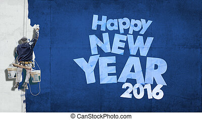 Happy 2016 on facade blue - Building painter hanging from ...