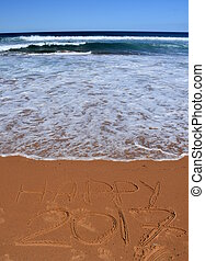 """Happy 2017 written on sand at sunset. Happy 2017 lettering on the beach. """"Happy 2017"""" drawn on sand on a beach, closeup shot. Happy 2017  written in sand, on tropical beach."""