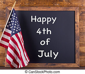 """""""Happy 4th of July"""" Text on a Chalkboard with American Flag"""