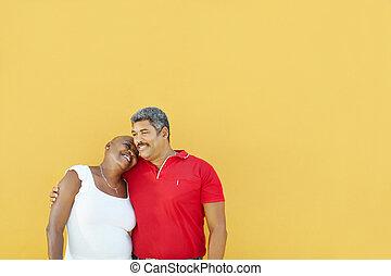 happy 50 years old man embracing woman - mature latin...