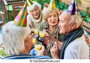 Happy 70th Birthday - Group of cheerful senior people...