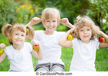 Happy active kids with apples