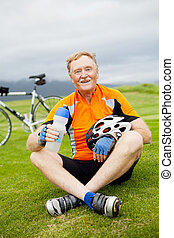 happy active senior bicyclist