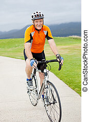 happy active senior man riding bicycle