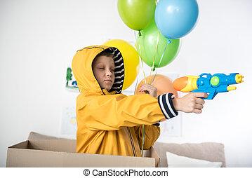 Happy adolescent boy testing his new toy