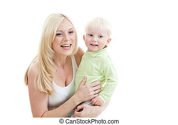 Happy adorable mother taking her  child in arms. Studio shot isolated.