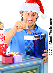 Happy Adult Caucasian Male Opening Gift