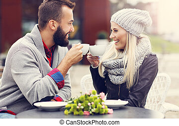 Happy adult couple dating in cafe - Picture showing happy...