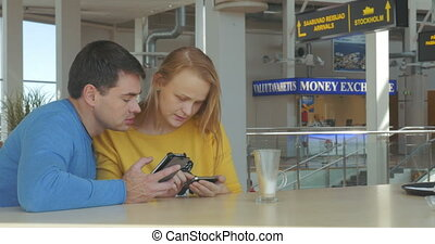Happy Adult Couple With Smart Phones