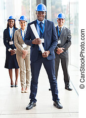 african american architect standing in front of colleagues