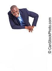 businessman behind white board