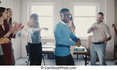 Happy African American businessman dancing. Casual man...