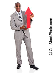 african american businessman holding red arrow
