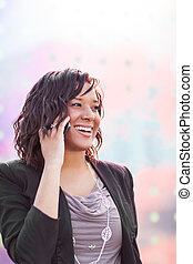 Happy African American businesswoman talking on the phone
