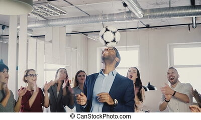 Happy African American CEO juggling ball on head. Multi...