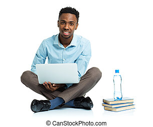 Happy african american college student with laptop on white