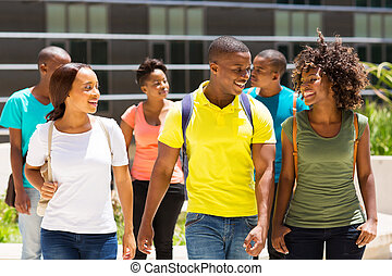 african american college students walking together