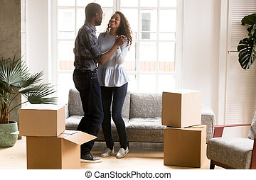 Happy African American couple dancing after moving