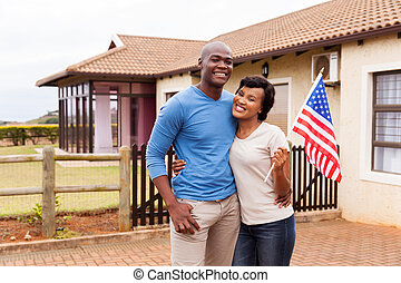 african american couple holding USA flag