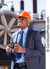 african american electrical businessman with binoculars