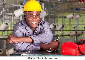 factory technician repairing loom