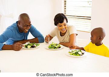 african american family eating meal together