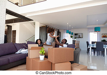 Happy African American family having fun on moving day