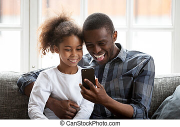 Happy African American family having fun together