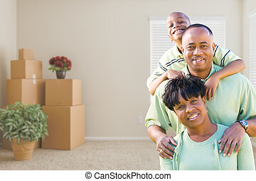 African American Family In Room with Packed Moving Boxes