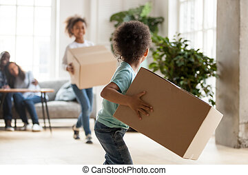 Happy African American family moving in new house
