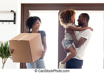 Happy African American family moving in new own house