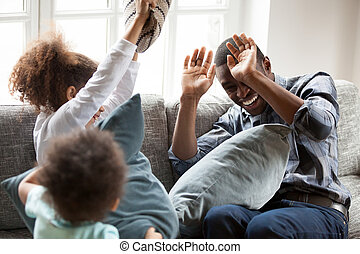Happy African American family playing together at home