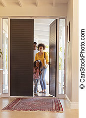 Happy African American family returning sweet home
