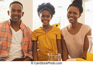 Happy African American family smiling at camera
