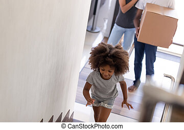 Happy African American family with daughter moving in new house