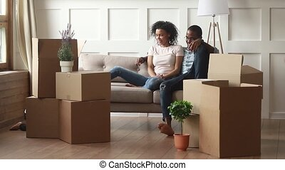 Happy african american family with kids on moving day concept