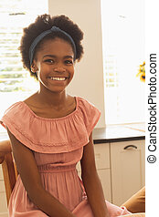 Happy African American girl looking at camera