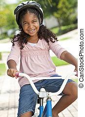 Happy African American Girl Riding Bike Smiling