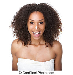 Happy african american girl with cream on nose